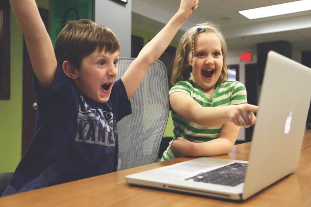 kids excited about laptop