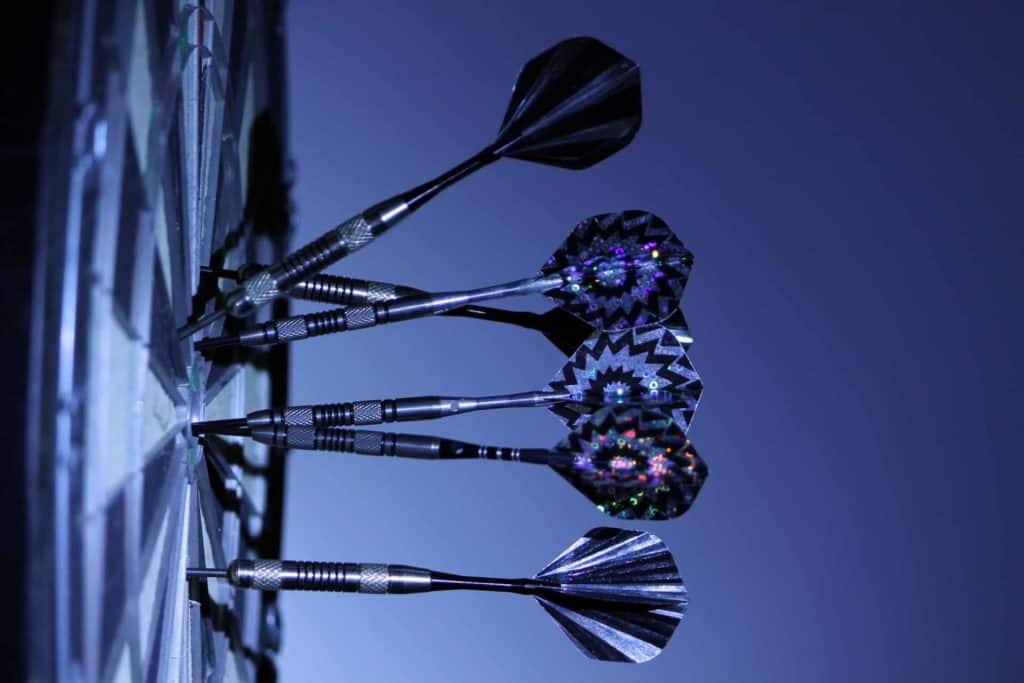 darts thrown into dartboard