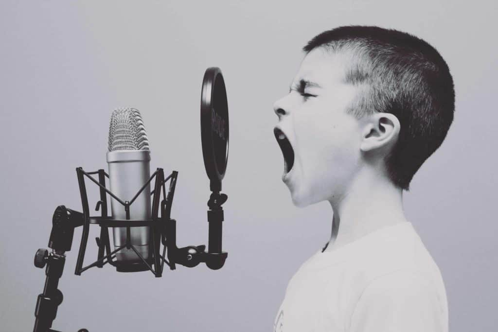 child screaming into mic