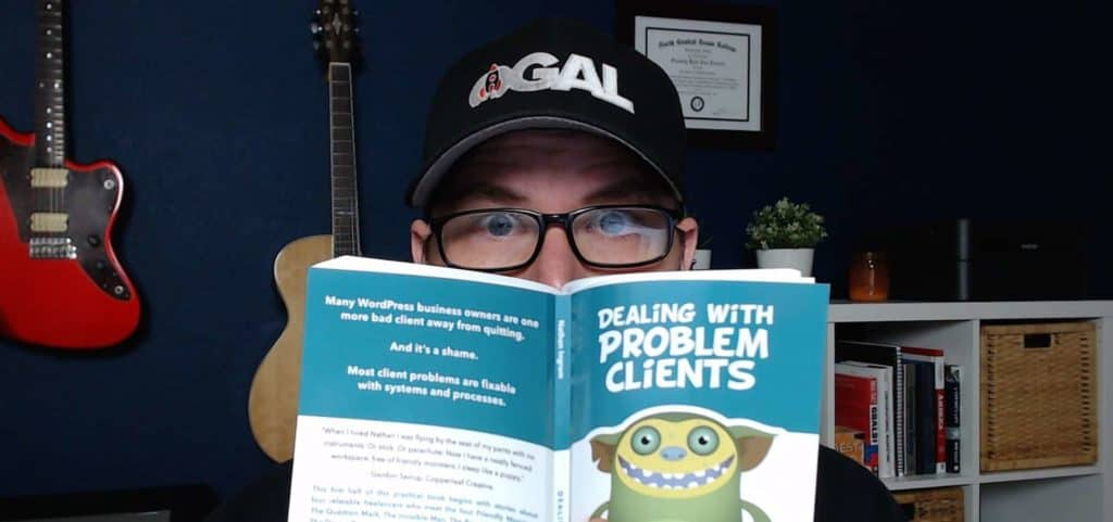 kyle reading the book dealing with problem clients