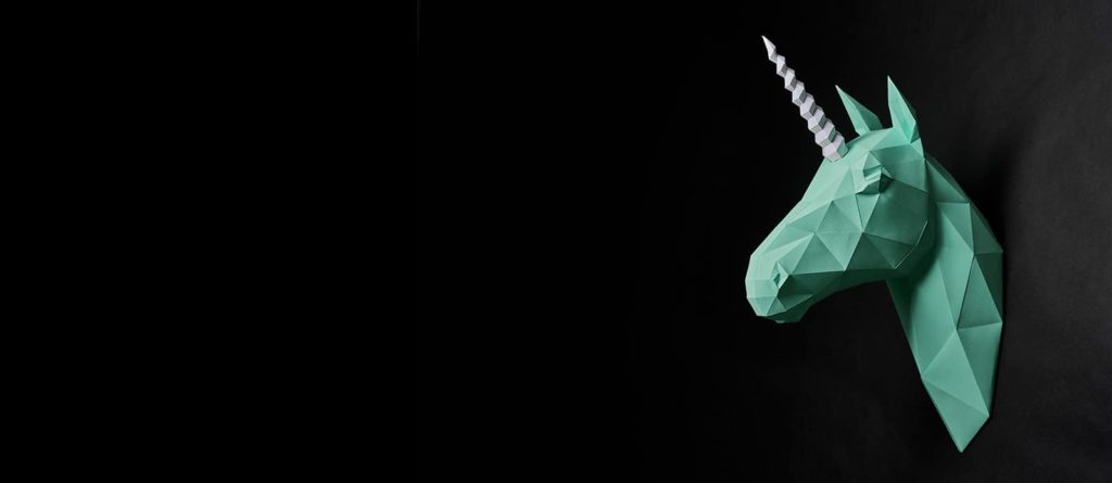 Origami Dull Green Unicorn's Head Hanging On Black Wall.